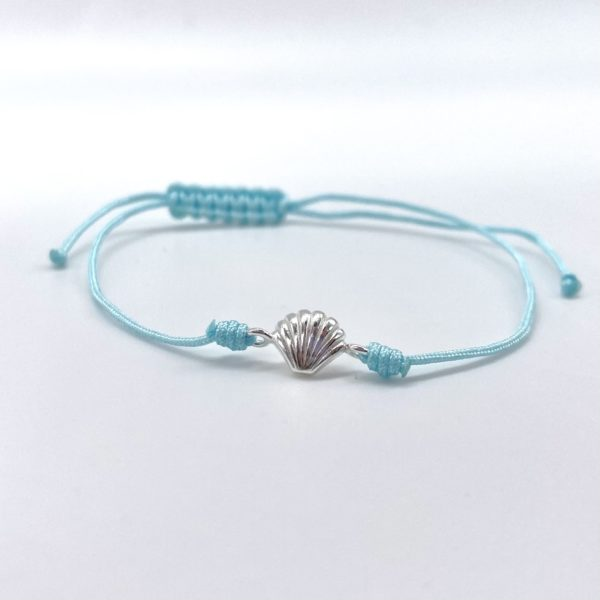 Turquoise blue bracelet with silver Shell.